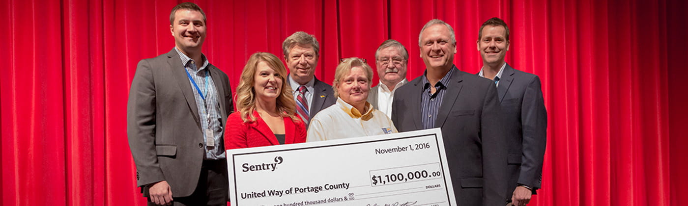 Sentry associates presenting United Way donation check