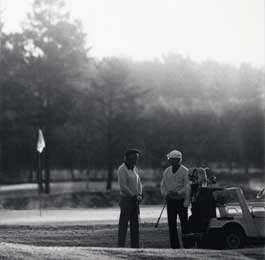Black and white photo of two golfers on the course
