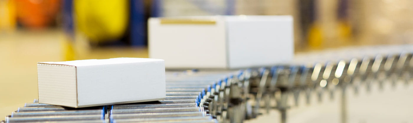 Packages on roller conveyor belt