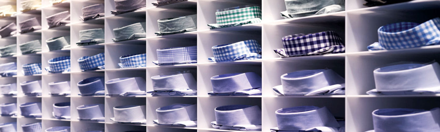 Rows of collared men's dress shirts
