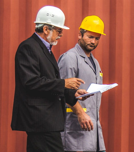 Two men with hard hats talking